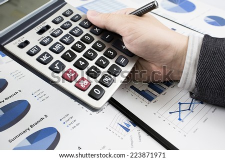 man hand with pen and business report. Accounting - stock photo