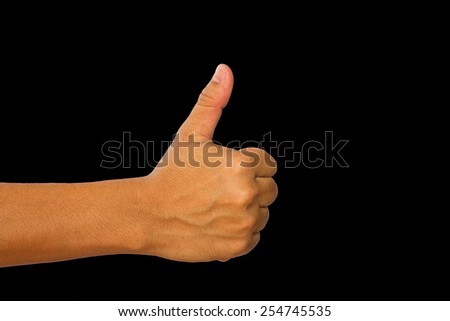 man hand with thumb up isolated on black background