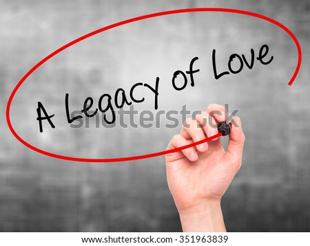Man Hand writing A Legacy of Love with black marker on visual screen. Isolated on background. Business, technology, internet concept. Stock Photo - stock photo