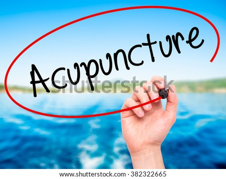 Man Hand writing Acupuncture with black marker on visual screen. Isolated on background. Business, technology, internet concept. Stock Photo - stock photo