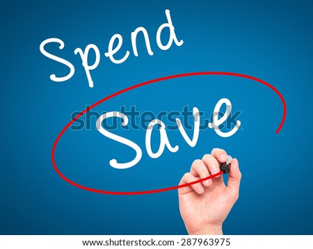 Man Hand writing and choosing Save instead of Spend with black marker on visual screen. Isolated on blue. Business, technology, internet concept. Stock Image - stock photo