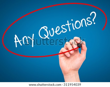 Man Hand writing Any Questions? with black marker on visual screen. Isolated on blue. Business, technology, internet concept. Stock Photo - stock photo