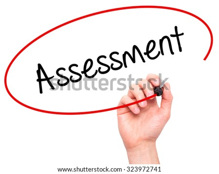 Man Hand writing Assessment with black marker on visual screen. Isolated on white. Business, technology, internet concept. Stock Photo - stock photo