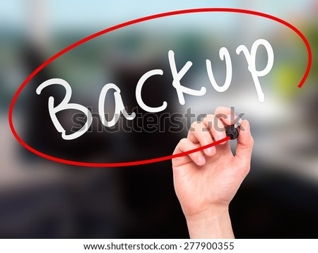 Man Hand writing Backup with marker on transparent wipe board. Isolated on office. Business, internet, technology concept.  Stock Photo - stock photo
