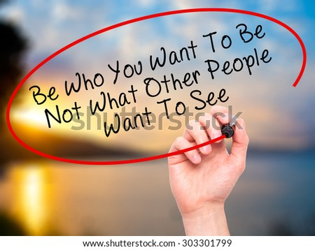 Man Hand writing Be Who You Want To Be Not What Other People Want To See with black marker on visual screen. Isolated on nature. Business, technology, internet concept. Stock Photo
