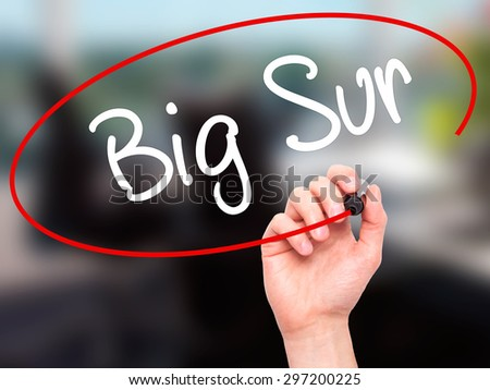 Man Hand writing Big Sur with black marker on visual screen. Isolated on office. Business, technology, internet concept. Stock Photo - stock photo