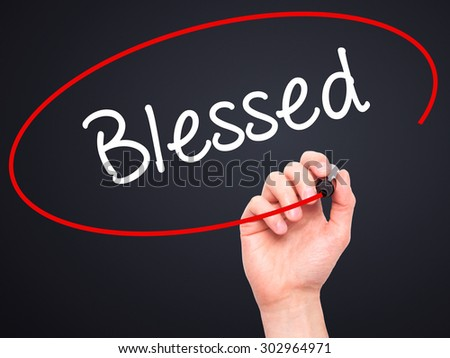Man Hand writing Blessed with black marker on visual screen. Isolated on black. Business, technology, internet concept. Stock Photo - stock photo