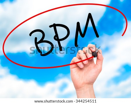 Man Hand writing  BPM (Business Process Management) with black marker on visual screen. Isolated on background. Business, technology, internet concept. Stock Photo - stock photo