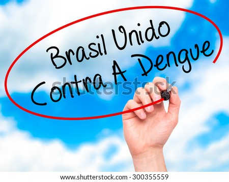 Man Hand writing Brasil Unido  Contra A Dengue (Brazil against Dengue in Portuguese) with black marker on visual screen. Isolated on sky. Business, technology, internet concept. Stock Photo - stock photo
