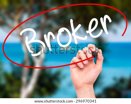 Man Hand writing Broker with black marker on visual screen. Isolated on nature. Business, technology, internet concept. Stock Photo - stock photo