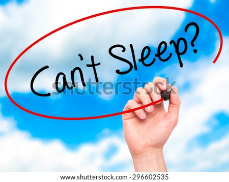 Man Hand writing Cant Sleep? with black marker on visual screen. Isolated on sky. Business, technology, internet concept. Stock Photo - stock photo