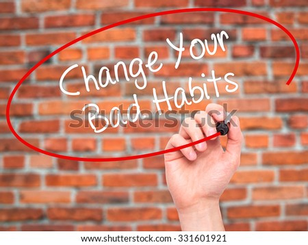 Man Hand writing Change Your Bad Habits  with black marker on visual screen. Isolated on bricks. Business, technology, internet concept. Stock Photo - stock photo