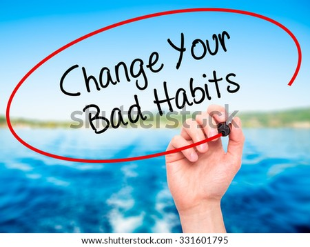 Man Hand writing Change Your Bad Habits  with black marker on visual screen. Isolated on nature. Business, technology, internet concept. Stock Photo - stock photo