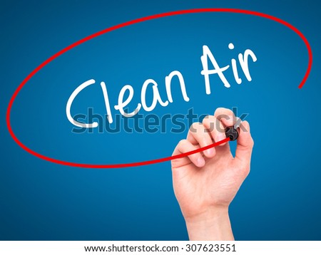 Man Hand writing Clean Air with black marker on visual screen. Isolated on blue. Business, technology, internet concept. Stock Photo - stock photo