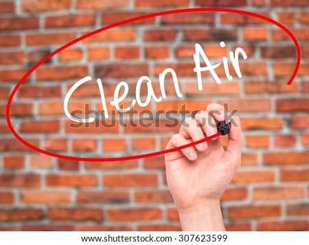 Man Hand writing Clean Air with black marker on visual screen. Isolated on bricks. Business, technology, internet concept. Stock Photo - stock photo