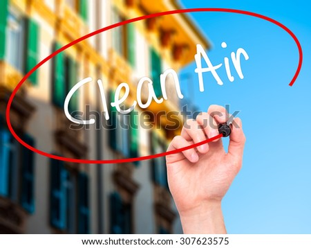 Man Hand writing Clean Air with black marker on visual screen. Isolated on city. Business, technology, internet concept. Stock Photo - stock photo