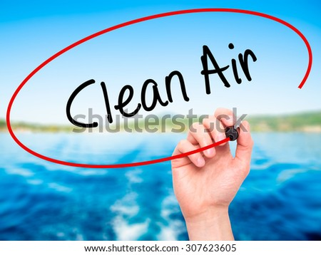 Man Hand writing Clean Air with black marker on visual screen. Isolated on nature. Business, technology, internet concept. Stock Photo - stock photo