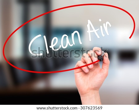 Man Hand writing Clean Air with black marker on visual screen. Isolated on office. Business, technology, internet concept. Stock Photo - stock photo