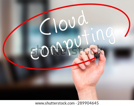 Man Hand writing Cloud computing with black marker on visual screen. Isolated on office. Business, technology, internet concept. Stock Image - stock photo