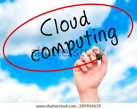 Man Hand writing Cloud computing with black marker on visual screen. Isolated on sky. Business, technology, internet concept. Stock Image - stock photo