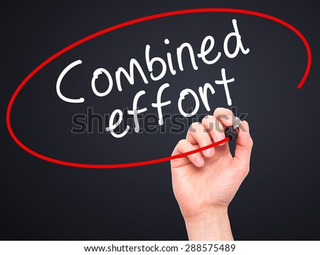 Man Hand writing Combined effort with black marker on visual screen. Isolated on black. Business, technology, internet concept. Stock Image - stock photo