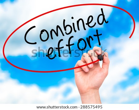 Man Hand writing Combined effort with black marker on visual screen. Isolated on sky. Business, technology, internet concept. Stock Image - stock photo