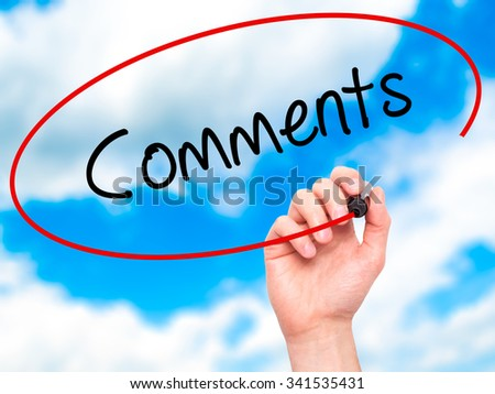 Man Hand writing Comments with black marker on visual screen. Isolated on sky. Business, technology, internet concept. Stock Photo - stock photo