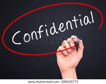 Man Hand writing Confidential with black marker on visual screen. Isolated on black. Business, technology, internet concept. Stock Image - stock photo