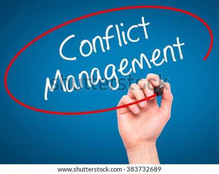 Man Hand writing Conflict Management with black marker on visual screen. Isolated on background. Business, technology, internet concept. Stock Photo