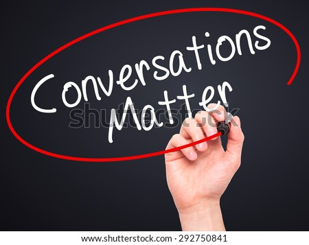 Man Hand writing Conversations Matter with black marker on visual screen. Isolated on black. Business, technology, internet concept. Stock Image - stock photo