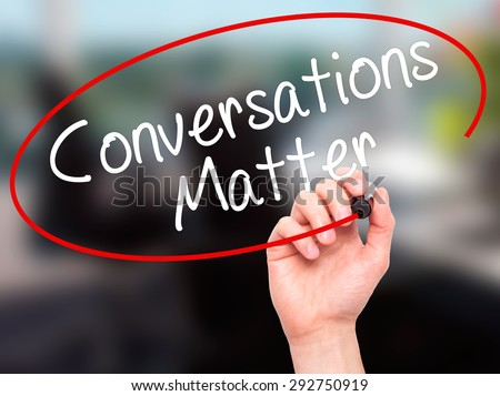 Man Hand writing Conversations Matter with black marker on visual screen. Isolated on office. Business, technology, internet concept. Stock Image - stock photo