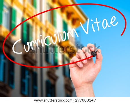 Man Hand writing Curriculum Vitae with black marker on visual screen. Isolated on city. Business, technology, internet concept. Stock Photo - stock photo