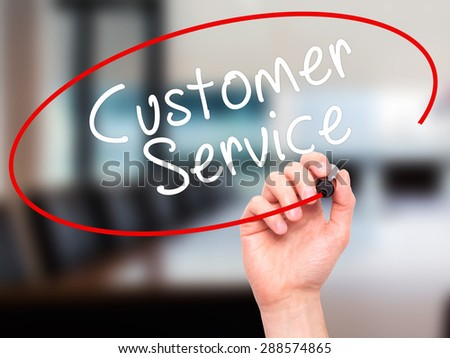 Man Hand writing Customer service with black marker on visual screen. Isolated on office. Business, technology, internet concept. Stock Image - stock photo