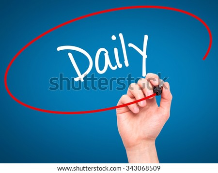 Man Hand writing Daily with black marker on visual screen. Isolated on blue. Business, technology, internet concept. Stock Photo - stock photo