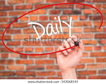 Man Hand writing Daily with black marker on visual screen. Isolated on bricks. Business, technology, internet concept. Stock Photo - stock photo