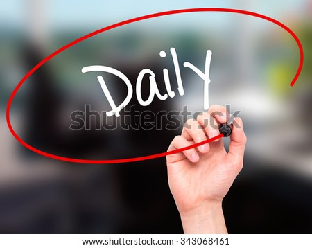 Man Hand writing Daily with black marker on visual screen. Isolated on office. Business, technology, internet concept. Stock Photo - stock photo