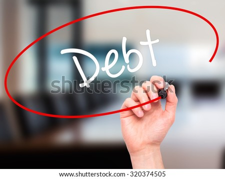 Man Hand writing Debt with black marker on visual screen. Isolated on office. Business, technology, internet concept.  - stock photo