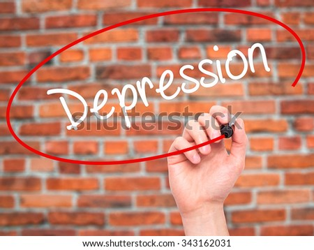 Man Hand writing Depression  with black marker on visual screen. Isolated on bricks. Business, technology, internet concept. Stock Photo - stock photo