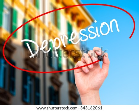 Man Hand writing Depression  with black marker on visual screen. Isolated on city. Business, technology, internet concept. Stock Photo - stock photo