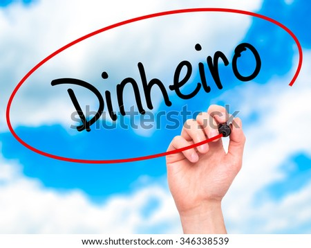 Man Hand writing Dinheiro (Money in Portuguese) with black marker on visual screen. Isolated on background. Business, technology, internet concept.
