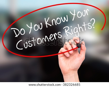 Man Hand writing Do You Know Your Customers Rights? with black marker on visual screen. Isolated on background. Business, technology, internet concept. Stock Photo