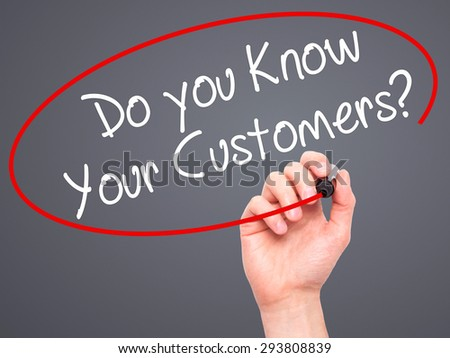 Man Hand writing Do you Know your Customers? with black marker on visual screen. Isolated on office. Business, technology, internet concept. Stock Photo - stock photo