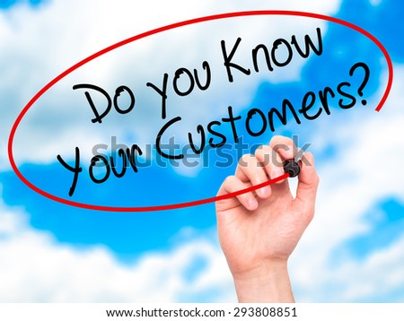 Man Hand writing Do you Know your Customers? with black marker on visual screen. Isolated on sky. Business, technology, internet concept. Stock Photo - stock photo