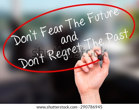 Man Hand writing Don't Fear The Future and Don't Regret The Past with black marker on visual screen. Isolated on office. Life, technology, internet concept. Stock Image - stock photo