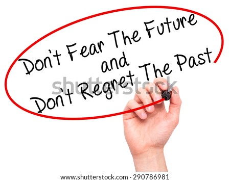 Man Hand writing Don't Fear The Future and Don't Regret The Past with black marker on visual screen. Isolated on white. Life, technology, internet concept. Stock Image - stock photo