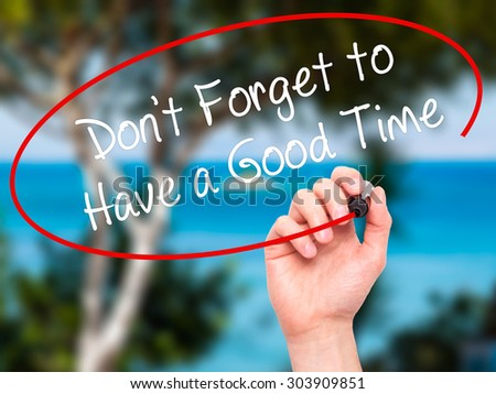 Man Hand writing Don't Forget to Have a Good Time with black marker on visual screen. Isolated on nature. Business, technology, internet concept. Stock Photo - stock photo