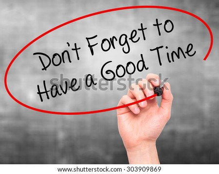 Man Hand writing Don't Forget to Have a Good Time with black marker on visual screen. Isolated on grey. Business, technology, internet concept. Stock Photo - stock photo