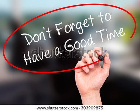 Man Hand writing Don't Forget to Have a Good Time with black marker on visual screen. Isolated on office. Business, technology, internet concept. Stock Photo - stock photo