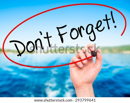 Man Hand writing Don't Forget!  with black marker on visual screen. Isolated on nature. Adoption, technology, internet concept. Stock Photo - stock photo