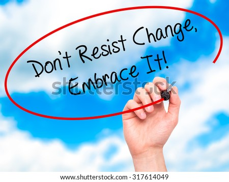 Man Hand writing Don't Resist Change, Embrace It! with black marker on visual screen. Isolated on sky. Business, technology, internet concept. - stock photo